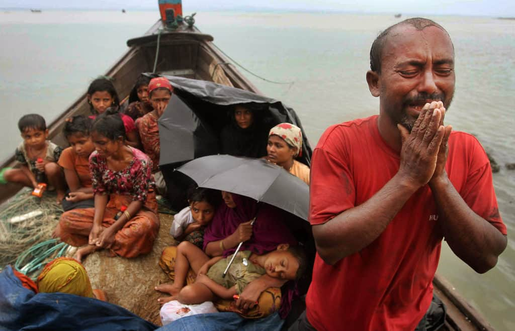 The Rohingya were crowded on boats after the military burned their villages, tortured and killed their men, and raped their women.
